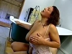 Busty housewife screwed in bathroom