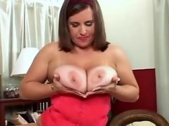 Busty chubby beauty in red titfucks