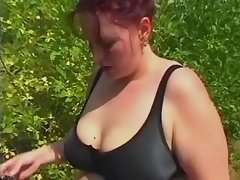 Chubby lady licking balls in nature
